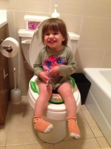 A whole lot of cuteness on the potty.